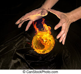 burning crystal ball and hands - high angle shot of a...