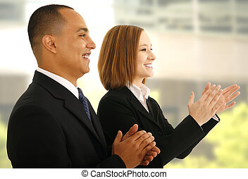 Clap Hand - two business people clapping hand in office...