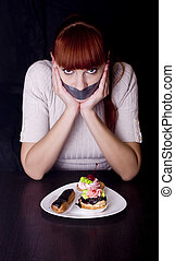 girl with her mouth sealed with adhesive tape and cakes -...