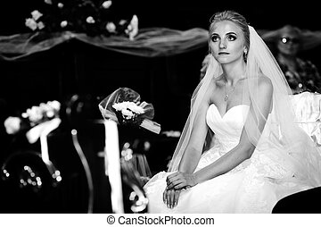Emotional innocent bride posing at wedding ceremony in church b&w