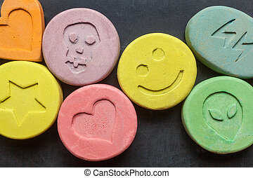 Ecstasy pills - Ecstasy tablets on black background