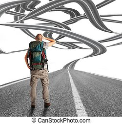 Winding road - Confused explorer man before a winding road