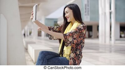 Woman taking a self portrait with tablet - Happy single...