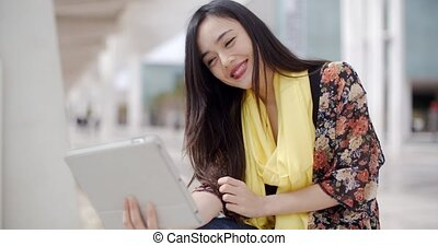 Cheerful female gesturing for tablet camera - Cheerful...