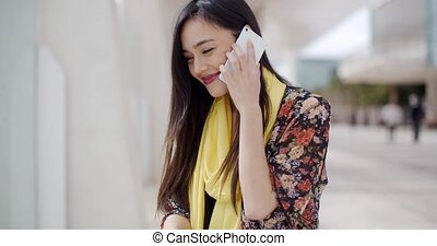 Young woman listening to a call on her mobile - Attractive...