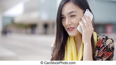 Smiling happy woman using a mobile phone - Smiling happy...