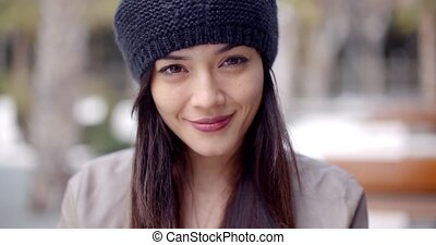Pretty thoughtful young woman in a woolly cap - Pretty...
