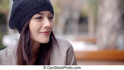 Cute smiling young woman in knitted hat - Cute single adult...