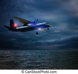 airplane over the sea in a storm