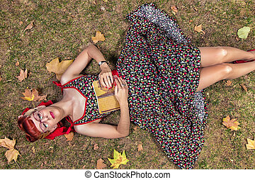Woman reading in the park.