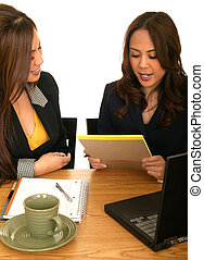 Business Women Working Together - two business women working...