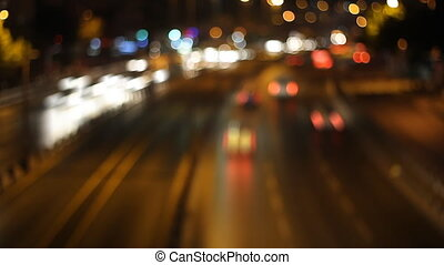 Blurred timelapse night traffic from above, city street, red...