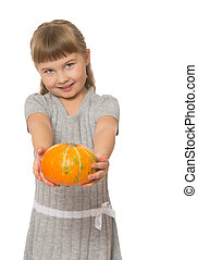 Girl holding a pumpkin - Cute little blond girl with short...