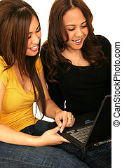 Teens Surfing On Internet - two young girls playing with...
