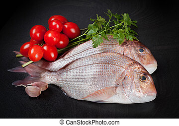 Dentex Fish - Raw Dentex fish with garlic, parsley and...