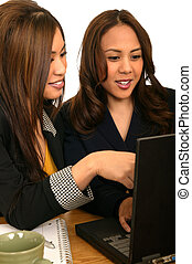 Women Business Team Discussing With Laptop 2 - business team...