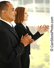 Business Team Clapping Hand - two business people clapping...