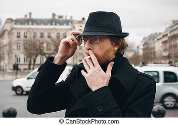 Attractive Bearded Man Smoking on the Street - Attractive...