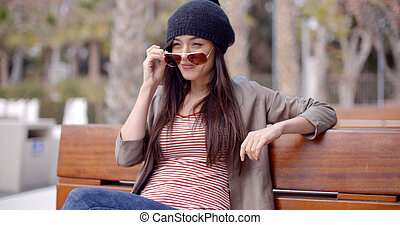 Trendy casual woman relaxing in a park