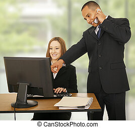 Business Team Working In Office - a man on the phone while...