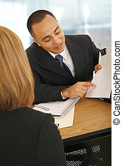 Discussing Agreement - business man showing empty paper to...