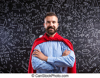 Teacher in red cape against big blackboard with mathematical...