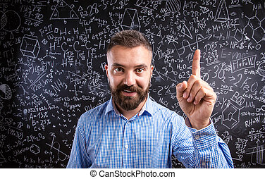 Scolding teacher against big blackboard with mathematical...