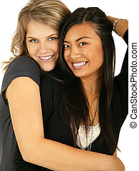 Best Friend Hugging 3 - isolated asian and caucasian girls...