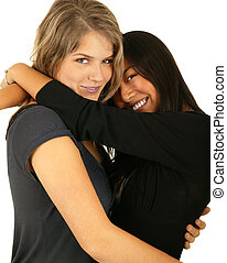 Best Friend Hugging - isolated asian and caucasian girls...