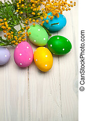 Easter eggs with branch of mimosa flowers