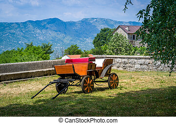 Horsedrawn carriage in Ostrog monastery lower church court....