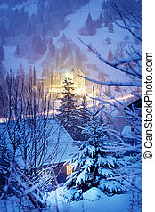 Glowing houses in winter mountains