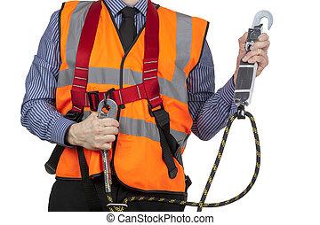 Building Surveyor in orange visibility vest securing safety...