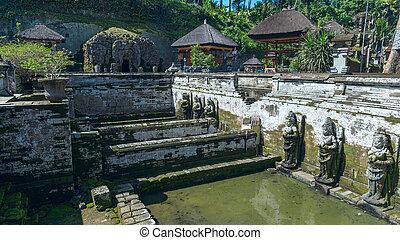 Sacred pool at Goa Gajah ancient temple in Bali, Indonesia