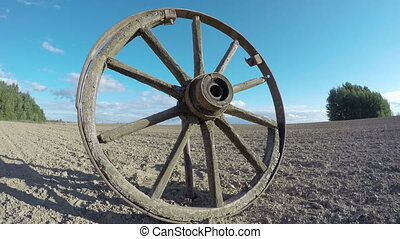 old wooden wheel in the field