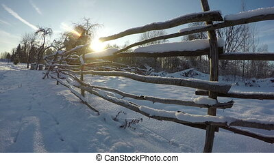 Sunset through wooden farm fence - Sunset seen through...