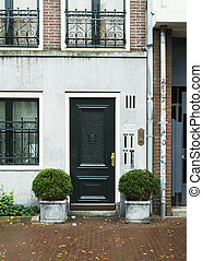 black door on a building - beautiful black door on the...