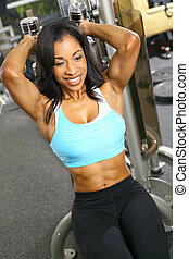 Tricep Training - african american woman training or...