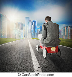 Toward to achievement - Man driving toward a city with...