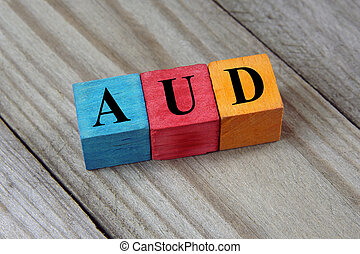 AUD (Australian Dollar) sign on colorful wooden cubes