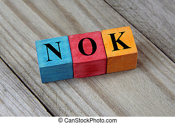 Norwegian Krone sign on colorful wooden cubes - NOK...