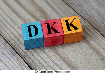DKK (Danish Krone) sign on colorful wooden cubes