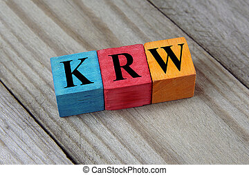 KRW (South Korean Won) sign on colorful wooden cubes