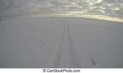 Ski tracks on snow on snow