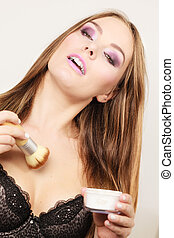 Woman in lingerie applying loose powder with brush - Woman...