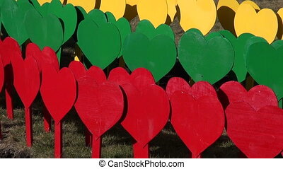 Lithuanian flag made painted hearts