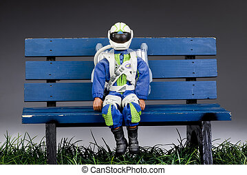 Rocket Man - Rocket man on a blue park bench