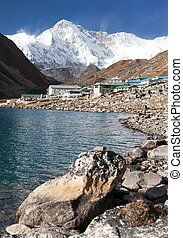 Gokyo lake and village with mount Cho Oyu - View of Gokyo...