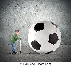 Big soccerball - Baby boy amused swollen a big soccer ball