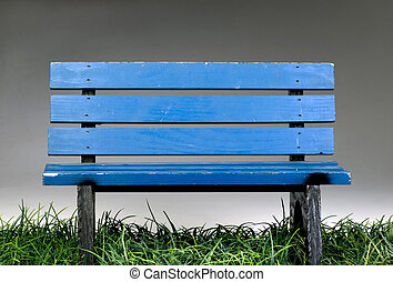 Old Blue Park Bench - Old blue park bench on green grass